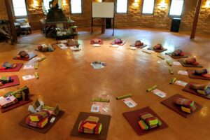 Meditation Hall set out with mats and cushions.